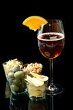 Long drinks with oranges and appetizers Stock Images