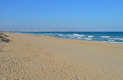 A Long And Empty Beach Royalty Free Stock Photos