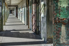 Long and Empty Hallway in Abandoned Military Fort stock image