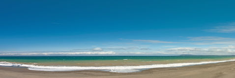 Long and empty ocean coast beach panoramic view background Royalty Free Stock Photo