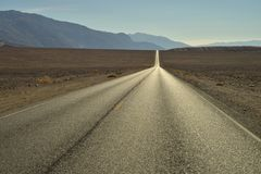Long empty desert road Death Valley National Park Royalty Free Stock Image
