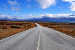 Long and empty road in Iceland Stock Images