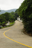 Long and Empty Road. An empty road on the island of Putuoshan located in Zhejiang Province China Royalty Free Stock Images