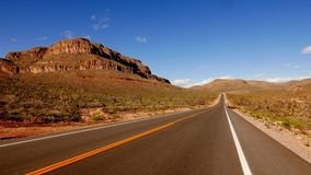 Long and empty road in south-west USA, Nevada in 4k. Video clip stock footage