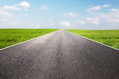 Long empty straight road, highway. Travel Royalty Free Stock Images