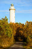 Long Erik lighthouse. The lighthouse Long Erik situated on the northern tip of Oland, Sweden. Here seen in late afternoon in autumn. Landscape is colorful and stock images