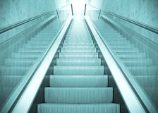 Long escalator Stock Images