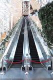 Long Escalator with Christmas Theme. One long escalator in the shopping mall with Christmas Theme Stock Image