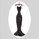 Long evening dress black on hangers. With a red bow Royalty Free Stock Images