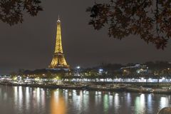 Illuminated Eiffel tower in Paris stock photography
