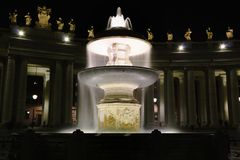 Long exposition of fountain in saint Peter square in Vatican. Long exposition at night of a fountain in saint Peter square in Vatican Royalty Free Stock Photos