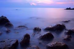 Long exposure. Of rocks at beach stock photo