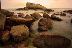 Long exposure. Of rocks at beach royalty free stock image