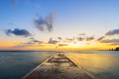Long Exposure At Sunset Of Cement Pier Royalty Free Stock Images