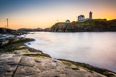 Long exposure of the Atlantic Ocean and Nubble Lighthouse at sun Royalty Free Stock Photo