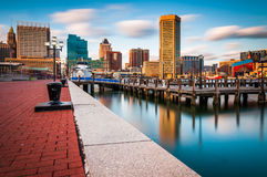 Long exposure of the Baltimore Skyline and Inner Harbor Promenade in Baltimore, Maryland. royalty free stock photo