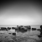 Long exposure bay. Beautiful long exposure black and white rocky seascape. black sea, odessa, ukraine Royalty Free Stock Images