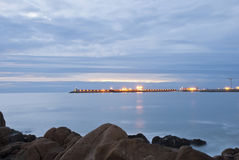 Long exposure of beach with pier Royalty Free Stock Images