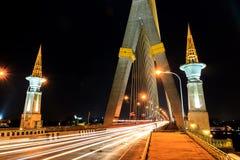 Long exposure of beam light on the road at Rama 8 Bridge , Bangk Stock Photo
