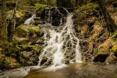 Long exposure of a beautiful waterfall in a forest in Mojonavalle Canencia Madrid stock photos