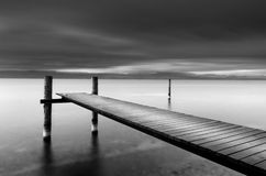 Long Exposure seascape with wooden pier and birds Stock Photography