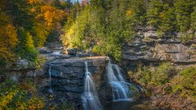 Fall foliage surrounding Blackwater Falls in West Virignia royalty free stock image