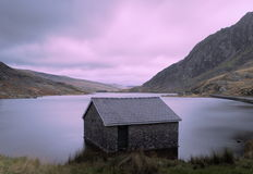Long exposure of a boat house at sunset stock photos
