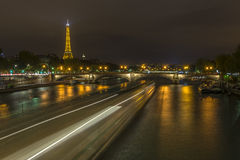 Long exposure of boats traffic in the Seine at night Stock Photo
