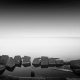 Long exposure breakwater. Black and white minimalistic seascape / daytime long exposure / black sea, odessa, ukraine Royalty Free Stock Images
