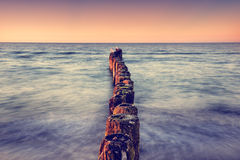 Long exposure breakwater photo. Baltic sea shore Stock Photo