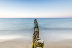 Long exposure breakwater photo. Baltic sea shore Royalty Free Stock Image