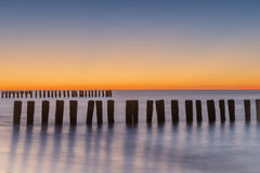 Long exposure breakwater photo. Baltic sea shore Stock Photos