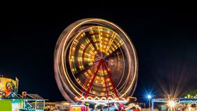 Long exposure capture on a ferris wheel on summer night Royalty Free Stock Image