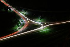 Long exposure car lights on roundabout below Arthur`s Seat, Edinburgh, Scotland stock photo