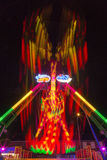 Long exposure carnaval ride. A carnaval ride I took, using a long exposure of several seconds, showing the red, green and yellow beams created by the leds from Royalty Free Stock Images