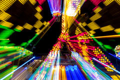 Long exposure carnaval ride. A carnaval ride I took, using a long exposure of several seconds, showing the red, green and yellow beams created by the leds from Stock Photo