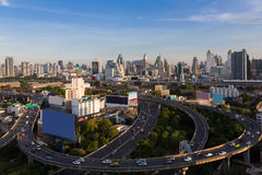 Long exposure city downtown background and highway road with clear blue sky, Bangkok Thailand Stock Images
