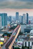 Long exposure city downtown road cross main river in Bangkok Stock Image