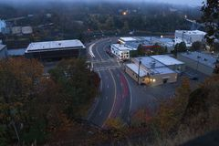 Long exposure of city traffic on a foggy morning royalty free stock photo