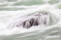 A Long Exposure Close Up of Rapids Flowing over a Rock in Niagara Gorge, Canada royalty free stock photo