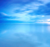 Long Exposure of clouds for background. Reflection of cloud at the beach at twilight royalty free stock image