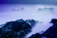 Long exposure on the coast. A long exposure with neutral density filters on a busy coastline Stock Images