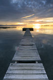 Long Exposure of a colorful sunrise in a pier placed in Mar Menor, Murcia Stock Photo
