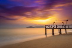 Long exposure of colorful sunrise and wooden pier Stock Images