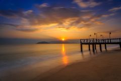 Long exposure of colorful sunrise and wooden pier Stock Photography