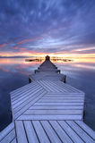 Long Exposure of a colorful sunrise in a zigzag pier placed in Mar Menor, Murcia Stock Image