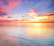Long Exposure of colorful sunset. Colorful sunset and its reflection royalty free stock photo