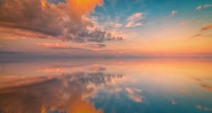 Long Exposure of Colorful sunset sky and reflection on sea. Vint. Age tone stock image