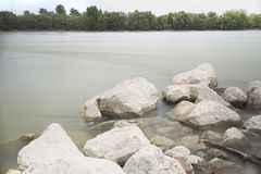 Long Exposure Danube Landscape. With Tree Line and White Rocks royalty free stock photo