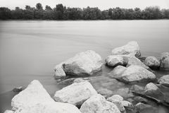Long Exposure Danube Landscape. With Tree Line and White Rocks royalty free stock photos